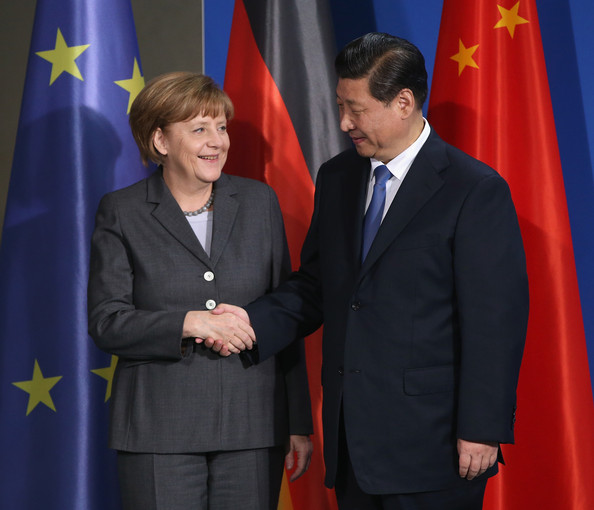 German Chancellor Angela Merkel and Chinese President Xi Jinping shake hands after speaking to the media following talks and the signing of bilateral agreements at the Chancellery on March 28, 2014 in Berlin, Germany. President Xi Jinping is on a two-day official visit to Germany. Copyright: Sean Gallup/Getty Images Europe