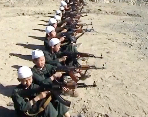 Boys at a Pakistan-based training camp fire AK-47's in this undated video released by the al-Qaeda affiliated Turkistan Islamic Party (TIP) terror group. [Video frame grab/Liveleak.com] From: Central Asia Online