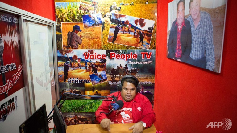 The leader of the Red Shirt Village movement, Arnon Sannan. The movement is a political initiative started by Thaksin's followers to consolidate rural support for pro-Thaksin parties. Copyright: AFP