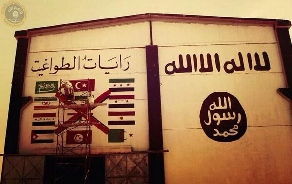 ISIS propaganda mural pointing out its adversaries. Note the curious absence of the American flag. From: @ajaltamimi