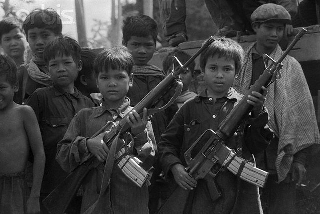 Young Khmer Rouge fighters with captured American firearms.