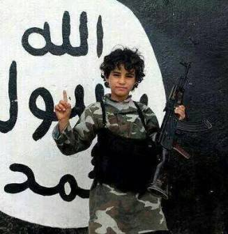 Nine year-old with rifle in ISIS controlled Iraq.